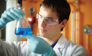 Male student working in a laboratory image